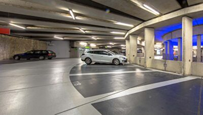 Two cars parked in a parking garage